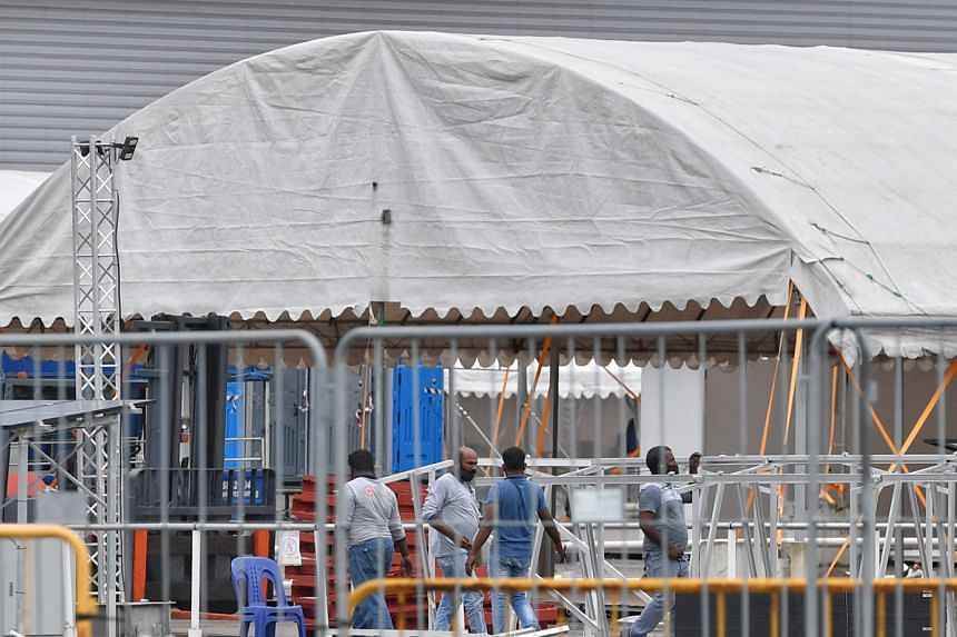Workers dismantling structures at the community care facility at Changi Exhibition Centre yesterday. As Covid-19 case numbers fall, some facilities have reverted to their original use while others have been repurposed as temporary accommodation sites