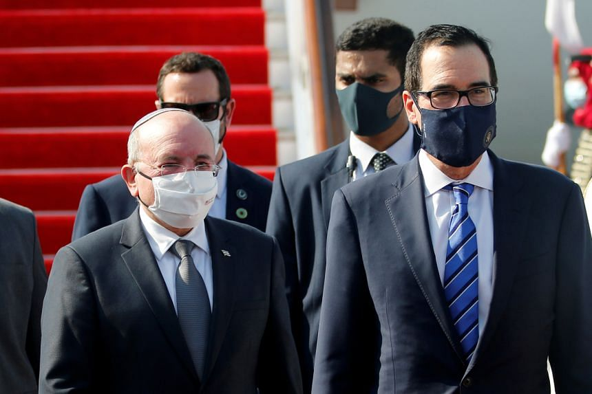 Israeli National Security Adviser Meir Ben-Shabbat (left) and US Treasury Secretary Steve Mnuchin arriving in Bahrain, yesterday. Bahrain followed the United Arab Emirates in agreeing to normalise ties with Israel.