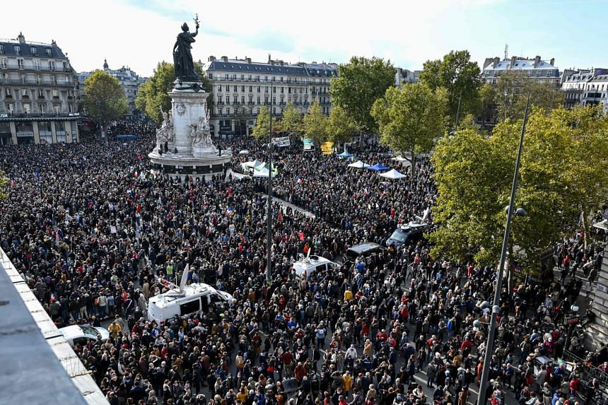 People gathering at the Place de la Republique in Paris yesterday, to pay homage to Mr Samuel Paty, who was decapitated two days ago by an attacker for showing cartoons of Prophet Muhammad to his pupils.