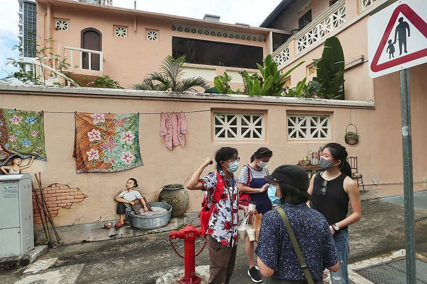 Tours will still be subject to prevailing social gathering sizes, which means that 20 people must be split into four groups, with no intermingling allowed, the STB said. ST PHOTOS: KELVIN CHNG, ONG WEE JIN
