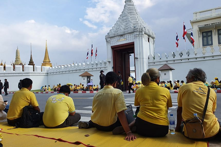 Hundreds of people dressed in yellow sat outside the Grand Palace, waiting to receive King Maha Vajiralongkorn.