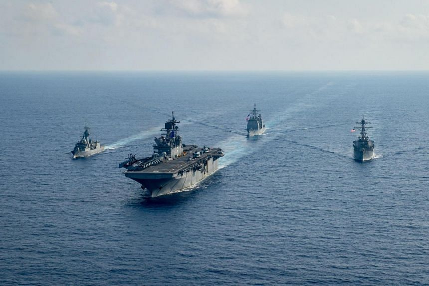 A Royal Australian Navy frigate sails with US Navy vessels in the South China Sea on April 18, 2020.