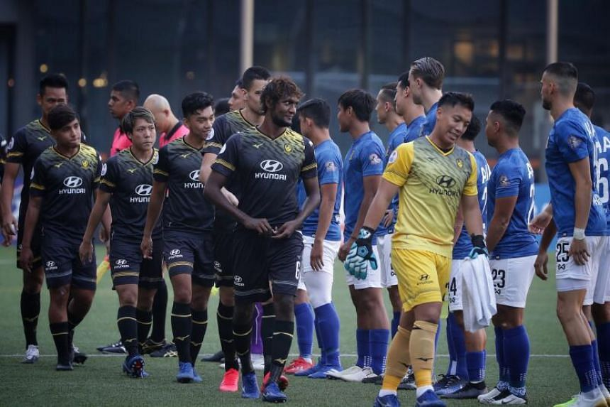 Players doing the customary pre-match greetings, without the usual handshakes, during the Singapore Premier League match between Tampines Rovers and Hougang United at Our Tampines Hub on Oct 17, 2020.