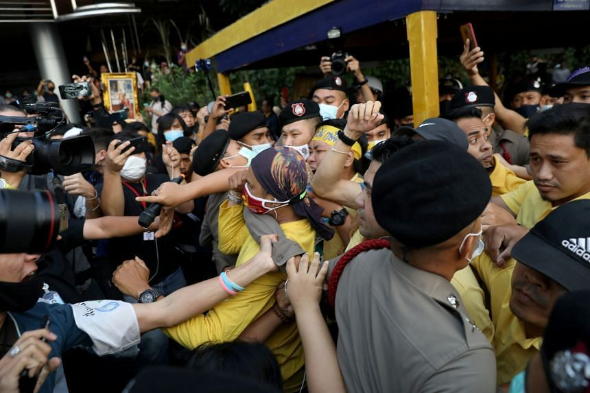 Police try to separate pro-democracy protesters and royalists during a clash in Bangkok, on Oct 21, 2020.