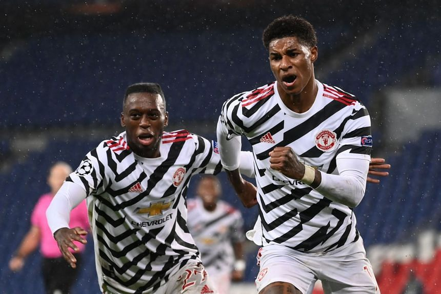 Marcus Rashford (right) netted three minutes from time.