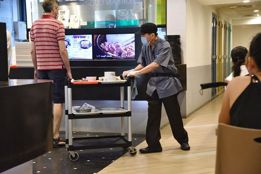 A cleaner working at Bugis Junction on Oct 11, 2020.