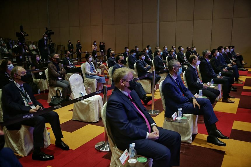 Attendees practising safe distancing during the Industrial Transformation Asia-Pacific opening ceremony at Singapore Expo & Max Atria yesterday. The event, which has gone hybrid for the first time, is the first in-person Mice event held at Singapore