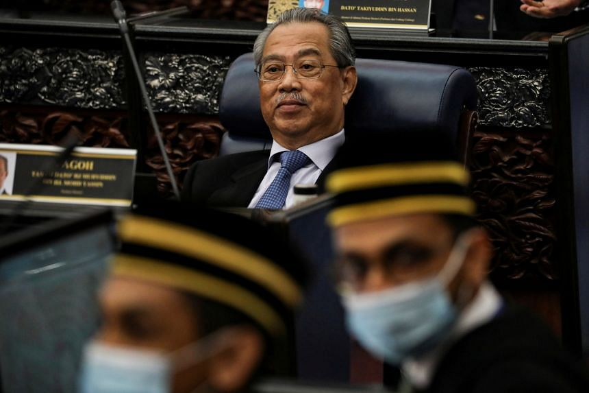 Umno had threatened to withdraw its support for Prime Minister Muhyiddin Yassin's (above) administration.