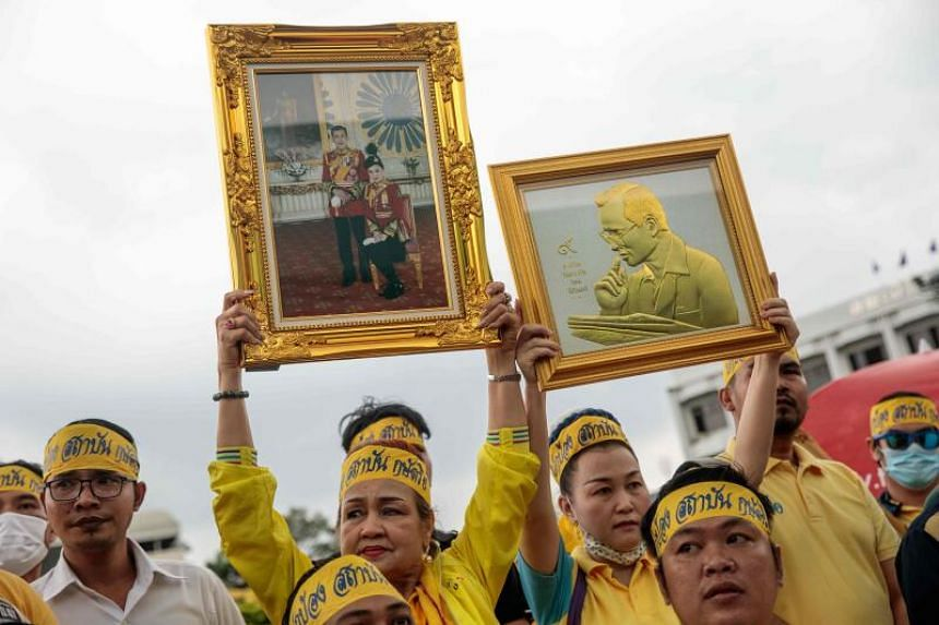 Members of a royalist group hold up framed pictures during a rally to show support for the Thai establishment at Ramkhamhaeng University in Bangkok on Oct 21, 2020.