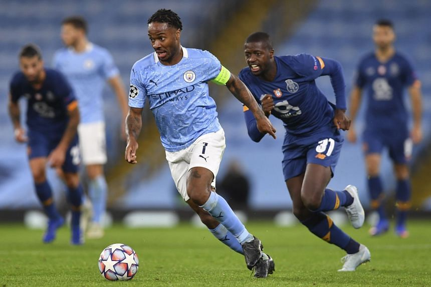 Raheem Sterling of Manchester City (left) in action against Nanu of Porto (right).