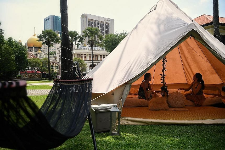 """One of the two tents for the two-day, one-night """"glamping"""" experience at the Malay Heritage Centre - between Dec 15 and 24 - is equipped with two queen-sized beds and a hammock, while another tent provides a space to watch movies with a projector scr"""