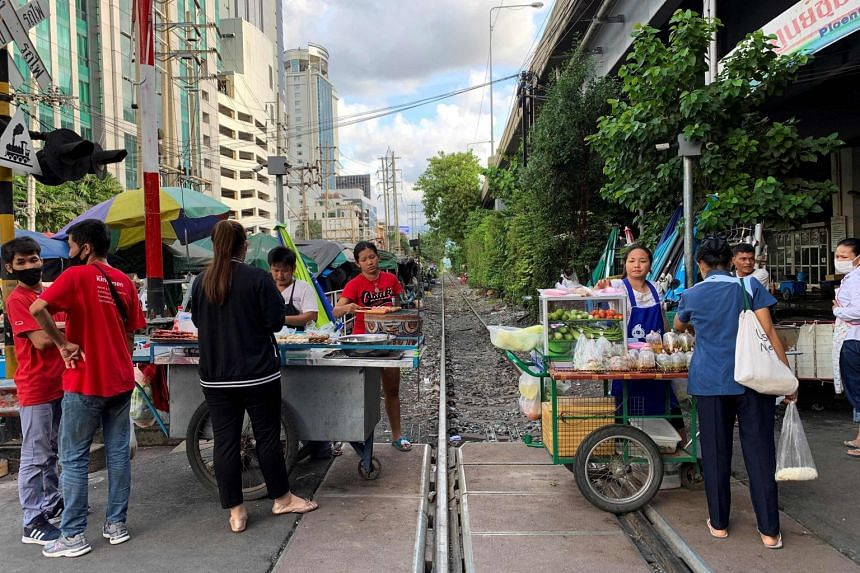 Street vendors selling food on a railway track in Bangkok on Sept 24, 2020.