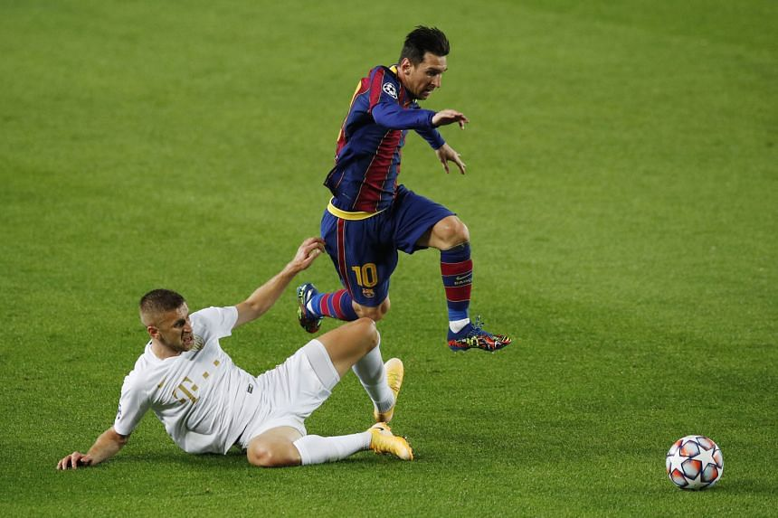 Barcelona captain Lionel Messi skipping past Ferencvaros' Eldar Civic during their Champions League match at the Nou Camp on Tuesday. He opened the scoring in the 5-1 win. PHOTO: REUTERS