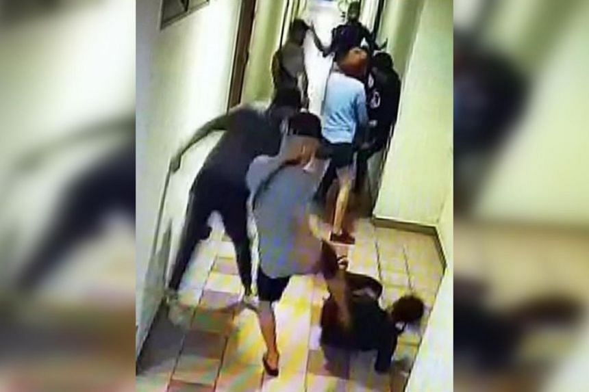 The brawl took place on the 16th storey of Block 101 Upper Cross Street, People's Park Centre on May 10, 2020.