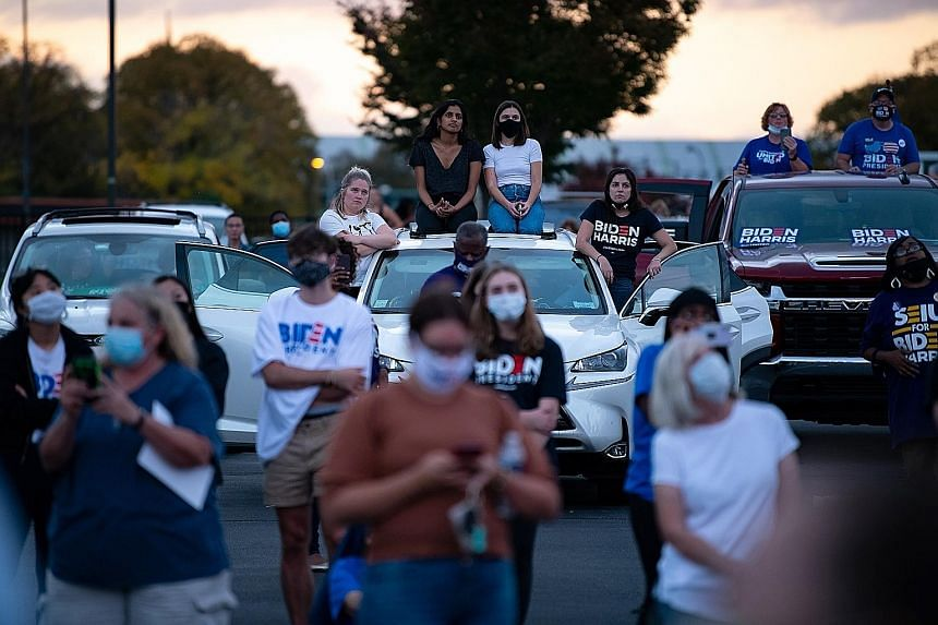 Attendees at Mr Obama's Wednesday drive-in rally during which he offered his fiercest critique yet of his successor taking aim at President Donald Trump's divisive rhetoric and his track record in the Oval Office. Former US president Barack Ob