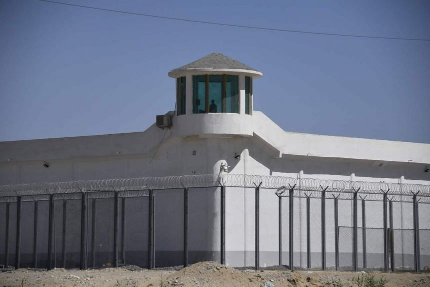 A photo taken on May 31, 2019, shows a watchtower near what is believed to be a re-education camp, in Xinjiang, China.