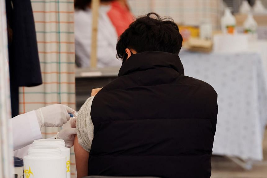 A man gets an influenza vaccine at a hospital in Seoul, South Korea, Oct 21, 2020.