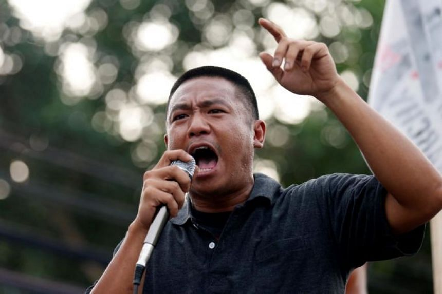 "Pro-democracy  protester Jatupat ""Pai"" Boonpattararaksa gives a speech after being released from Bangkok Remand Prison on Oct 23, 2020."