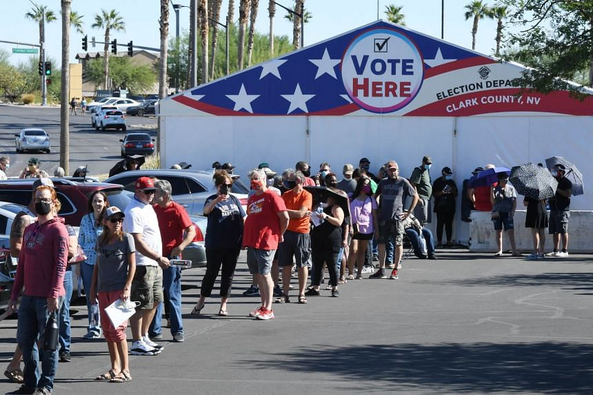 People line up to vote at a shopping centre on the first day of in-person early voting in Las Vegas, on Oct 17, 2020.