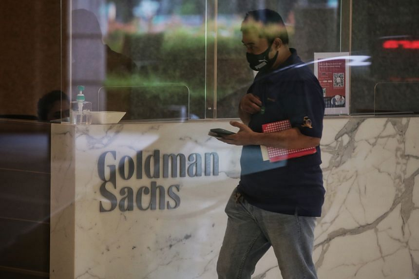 A man walks past the visitor registration counter for Goldman Sachs in the South Lobby of One Raffles Link on Oct 23, 2020.