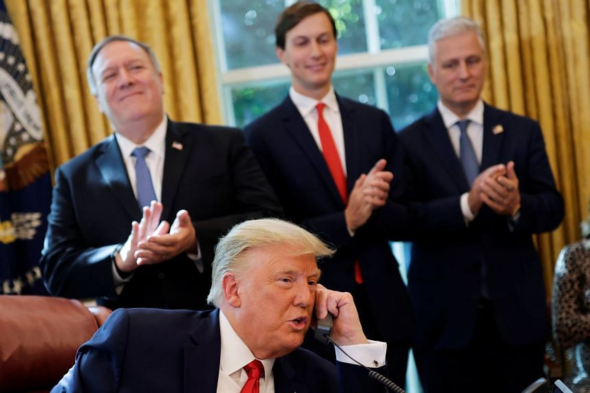 Mr Trump speaks on the phone with leaders of Israel and Sudan, at the Oval Office, on Oct 23, 2020.