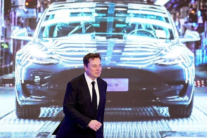 Tesla's CEO Elon Musk during the January opening ceremony for his company's China-made Model Y programme in Shanghai. Asia dominates manufacturing of the lithium ion cells used in electric vehicles and other electronic devices, accounting for more th