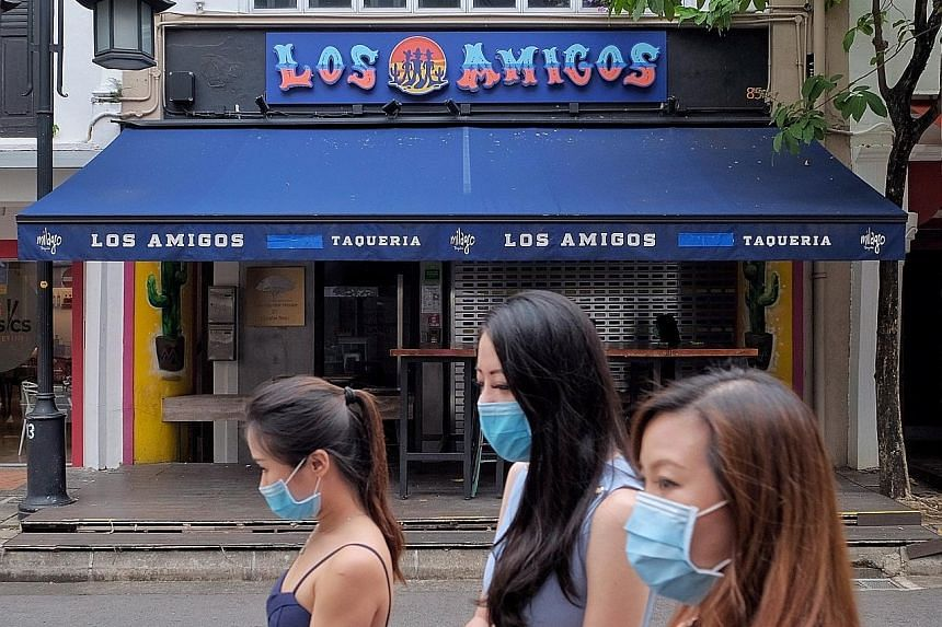 The Los Amigos restaurant in Circular Road was ordered to close from Thursday to Nov 10. The URA said that on Oct 10, its officers saw different groups of customers at the restaurant standing less than 1m apart from one another, and a gathering of ei