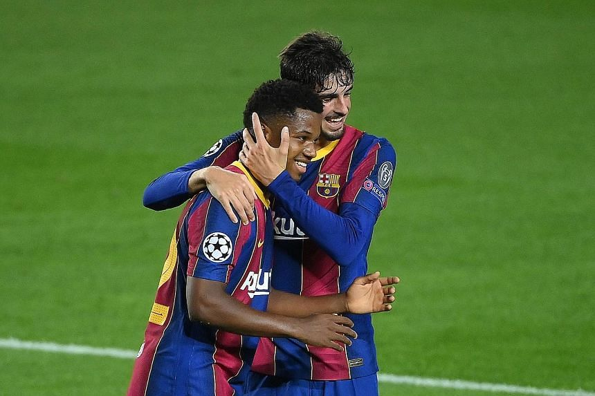 Barca forward Ansu Fati (left) celebrating with Francisco Trincao after scoring against Ferencvaros in the Champions League on Tuesday.