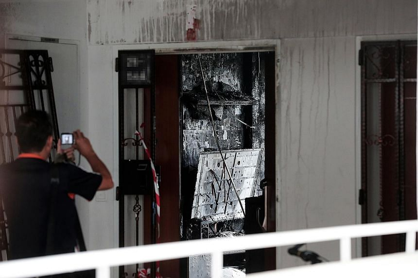 Private-hire driver Goh Keng Soon, 40, died two days after the fire broke out in his flat in Bukit Batok (left) in July last year. The coroner's court heard that the path to safety for him and his family might have been blocked as the burning persona