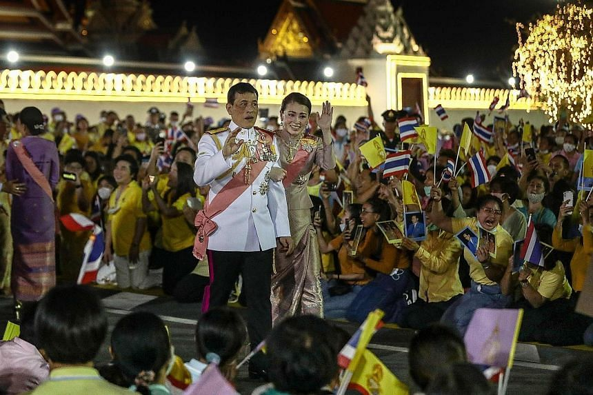 Thai King Maha Vajiralongkorn and Queen Suthida greeting royalist supporters after a Buddhist ceremony at the Grand Palace in Bangkok yesterday for the late King Chulalongkorn, known as Rama V, who earned a reputation as a moderniser.