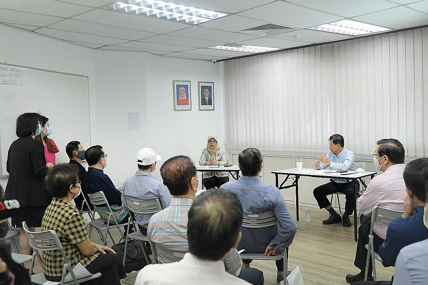 President Halimah Yacob and Mr Yeo Hiang Meng, president of The Federation of Merchants' Associations, Singapore), speaking at a dialogue with FMAS members in Joo Chiat yesterday. At the meeting, members highlighted the challenges that heartland busi