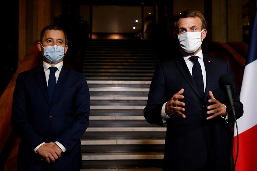 French President Emmanuel Macron (right) with interior minister Gerald Darmanin.