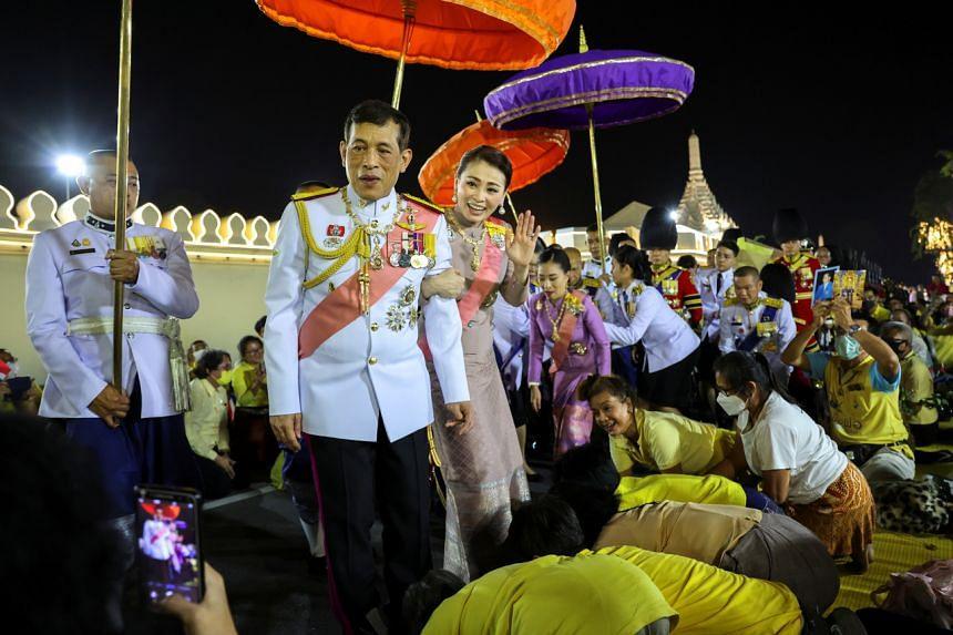 Thailand's King Maha Vajiralongkorn and Queen Suthida greeting royalists at the Grand Palace in Bangkok on Oct 23, 2020.
