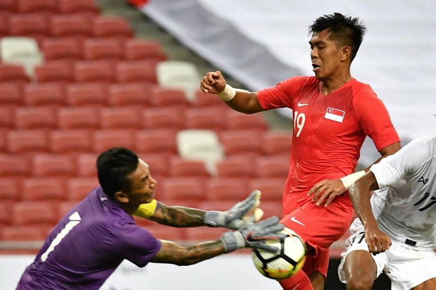 Singapore's Khairul Amri (in red) during a friendly match between Singapore and Myanmar at the National Stadium on June 11, 2019.