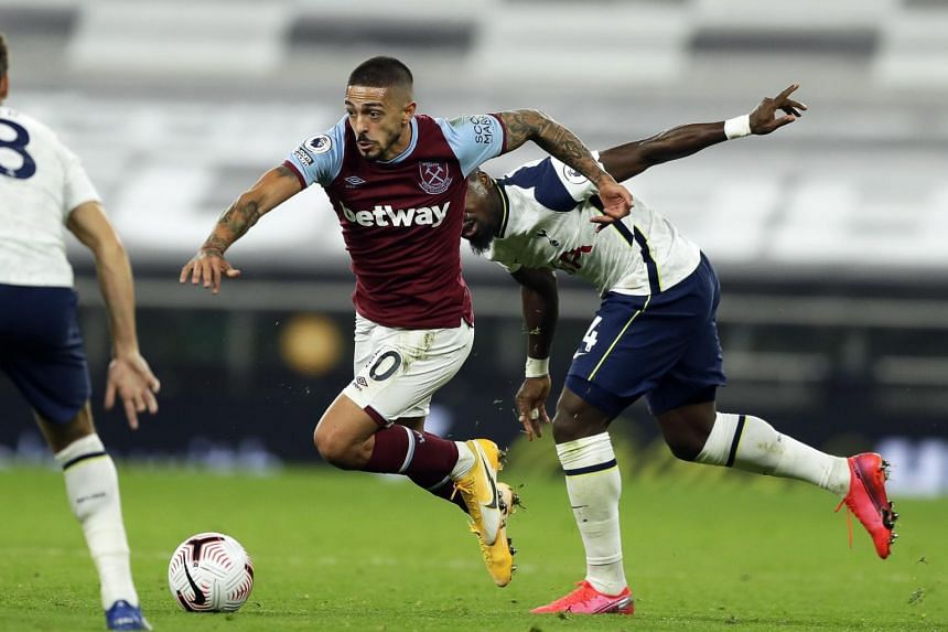 West Ham's Manuel Lanzini (left) in action against Tottenham's Toby Alderweireld during the match between Tottenham Hotspur and West Ham United in London on Oct 18, 2020.