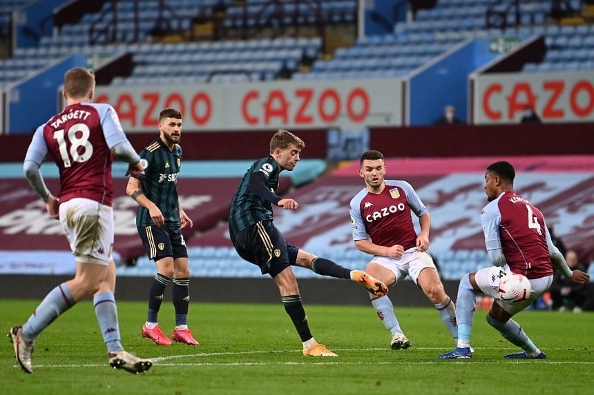 Patrick Bamford (centre) of Leeds United scores the 2-0 lead against Aston Villa.