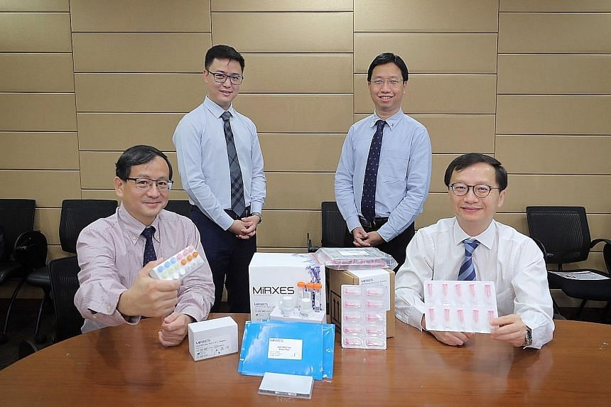From left: NUS Yong Loo Lin School of Medicine's Associate Professor Too Heng-Phon, MiRXES co-founder and CEO Zhou Lihan, NUH's Division of Gastroenterology and Hepatology consultant Calvin Koh and NUH's Professor Jimmy So with the gastric cancer tes