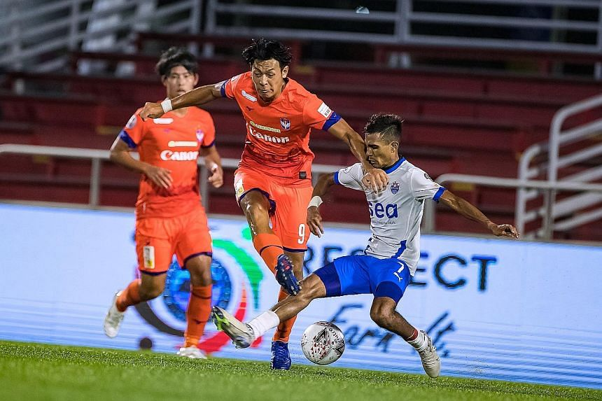 Lion City Sailors midfielder Aqhari Abdullah tackling Albirex Niigata forward Reo Nishiguchi in yesterday's SPL match at Jurong East Stadium. The White Swans' winner came amid controversy, as their opponents claimed there was a handball in the build-
