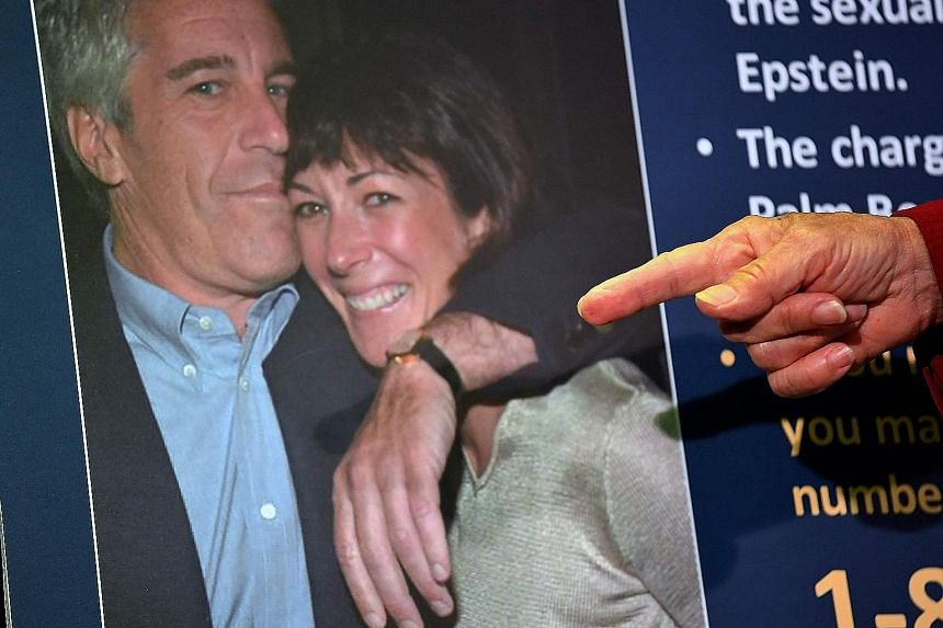A file photo of Ghislaine Maxwell and her former boyfriend Jeffrey Epstein shown during a press conference in New York City in July as charges were announced against the British socialite.