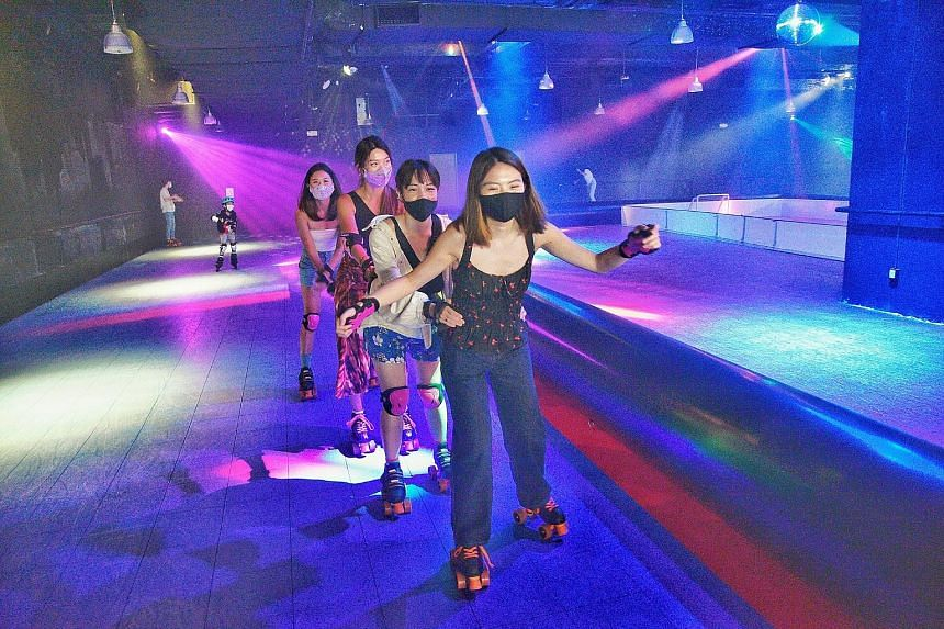 The reporter (in front) and her friends at retro-themed indoor skating rink Hi Roller Singapore.