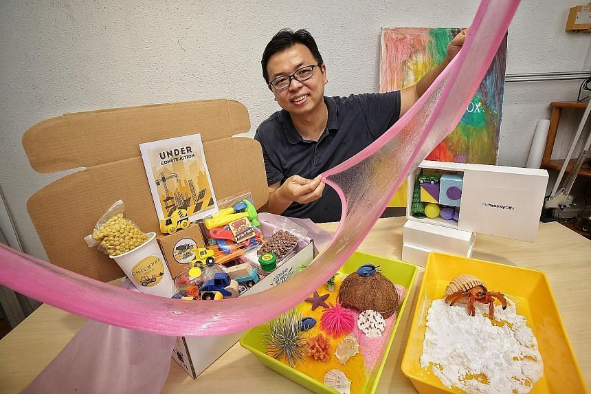 Mr Jeff Lim, founder of My Messy Box, with slime from one of the sensory play boxes he offers. Ms Shernice Goh, co-founder of One Happy Book, with her daughter Katelyn Grace Chandra.