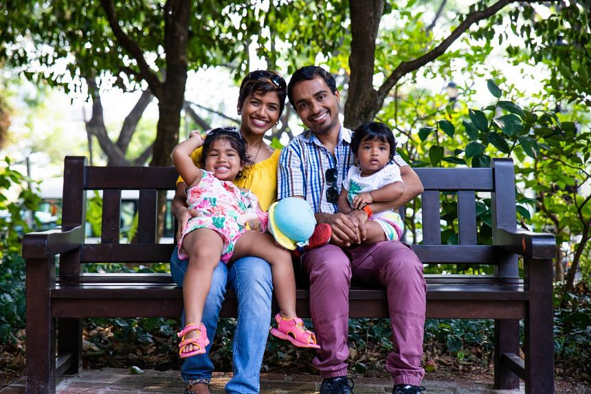 Mr Jason Blaise D'Souza with his wife Ms Lynda D'Costa and their two children.