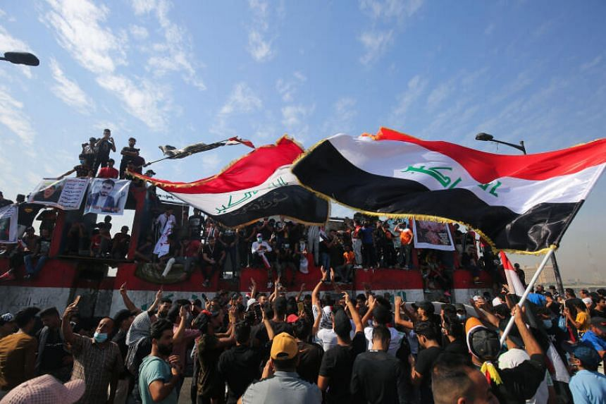 Iraqi demonstrators gather in Tahrir Square in the centre of the capital Baghdad, on Oct 25, 2020.