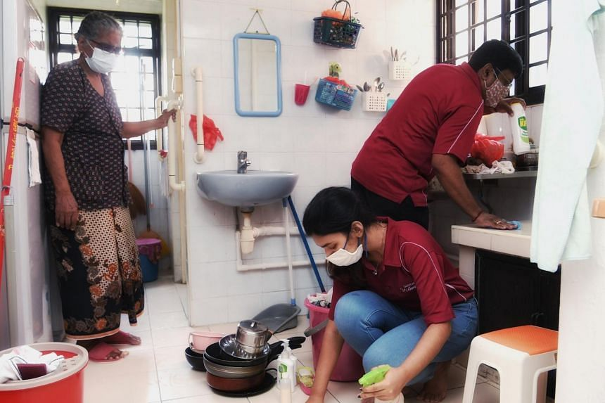 Volunteers sprucing up the home of Madam Govindamal Mariappan.
