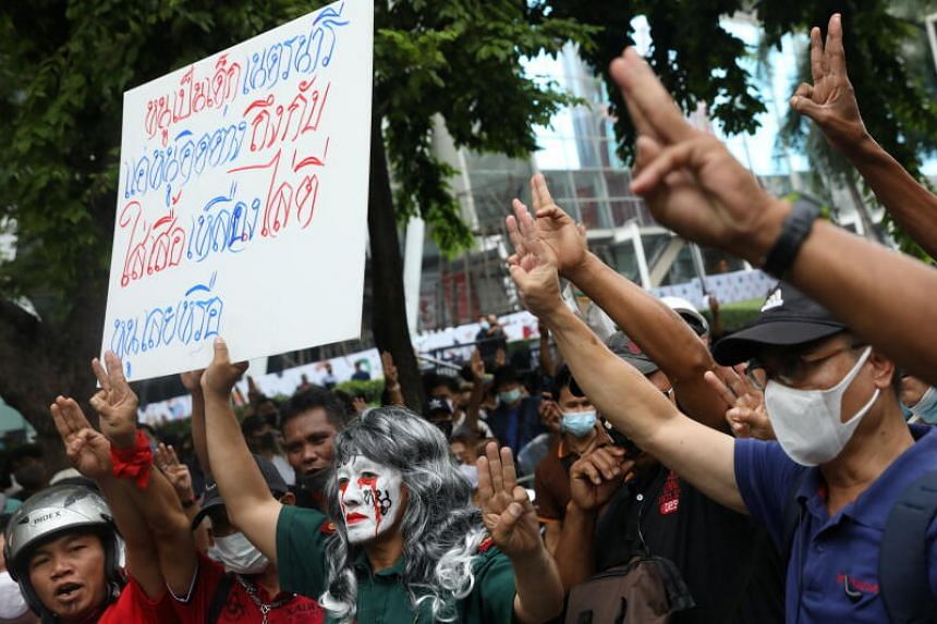 Pro-democracy protesters making the three-finger salute during a demonstration in Bangkok on Oct 25, 2020.