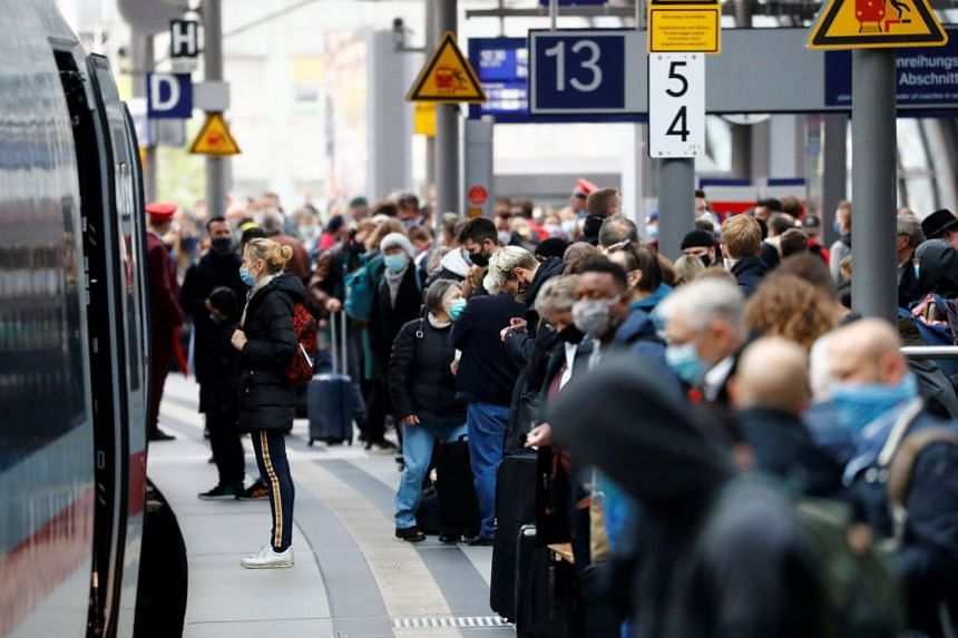 Commuters wait on a platform of the main train station, Hauptbahnhof, in Berlin, Germany.