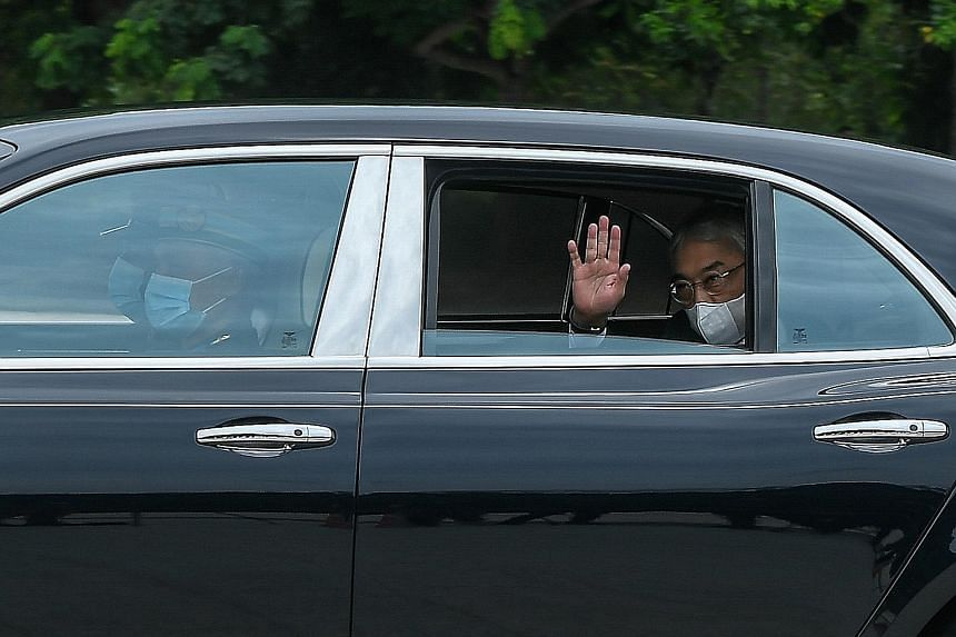 Malaysia's King, Sultan Abdullah Ahmad Shah, waving to reporters outside Istana Negara in Kuala Lumpur as he arrived for the meeting with other state monarchs yesterday. The motorcade of Malaysia's Sultan Abdullah Ahmad Shah leaving the compound of I