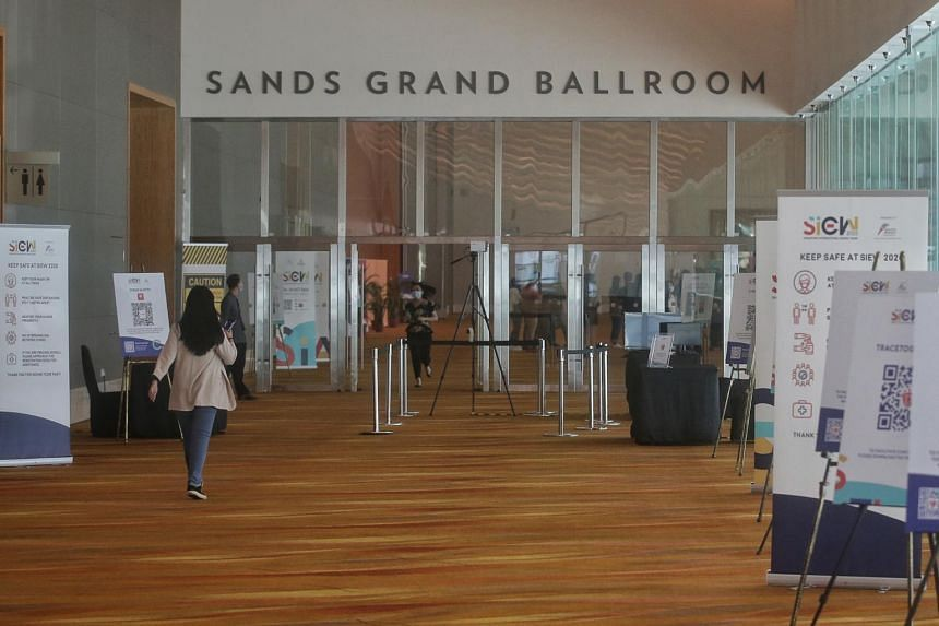 Staff at the Sands Grand Ballroom a day before the start of Singapore International Energy Week at Sands Expo and Convention Centre on Oct 25, 2020.