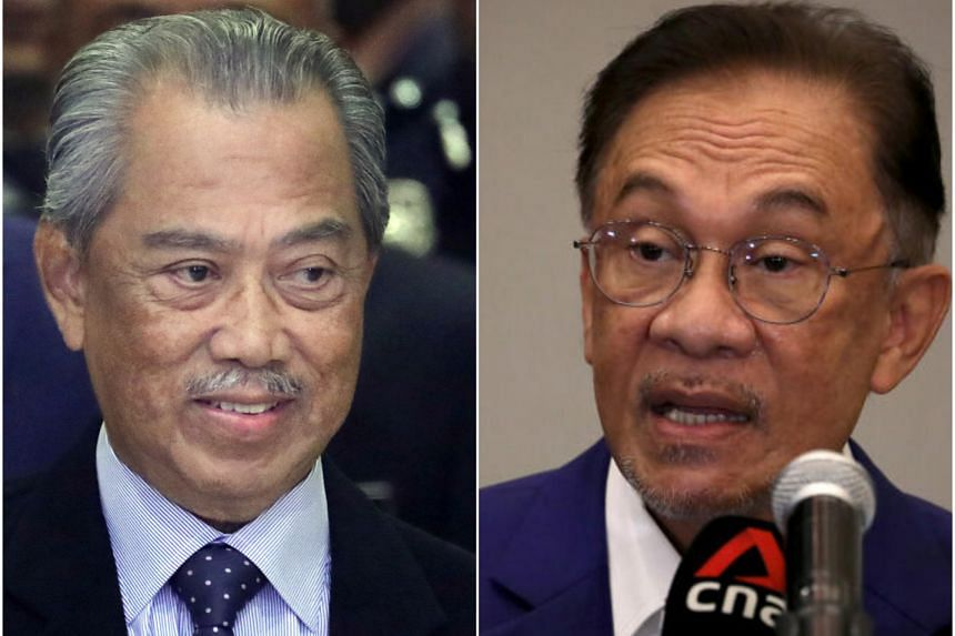 Opposition leader Anwar Ibrahim (right) could finally prove that he has the majority support over PM Muhyiddin Yassin.