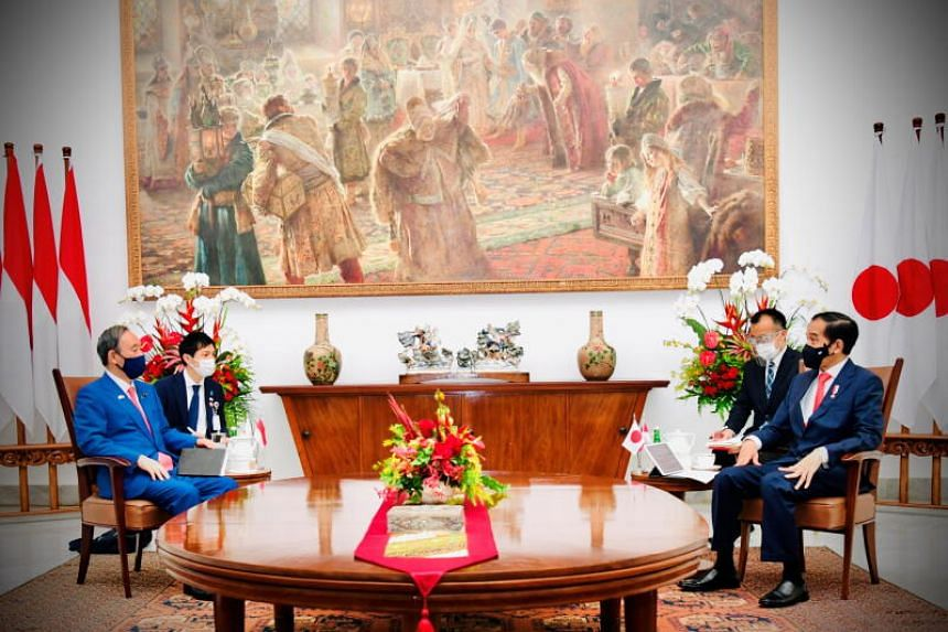 Japan's Prime Minister Yoshihide Suga talks with Indonesian President Joko Widodo during his visit at the Indonesian Presidential Palace in Bogor, Indonesia, Oct 20, 2020.